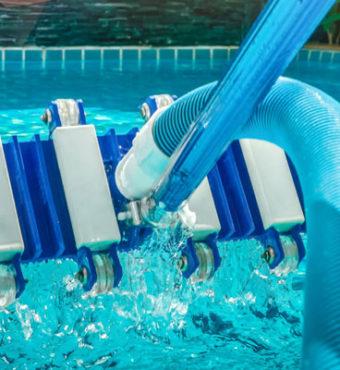Pool vacuum above pool water